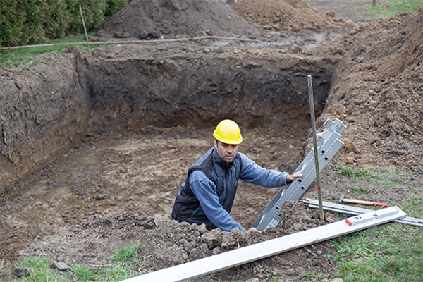 contractor in dirt pit